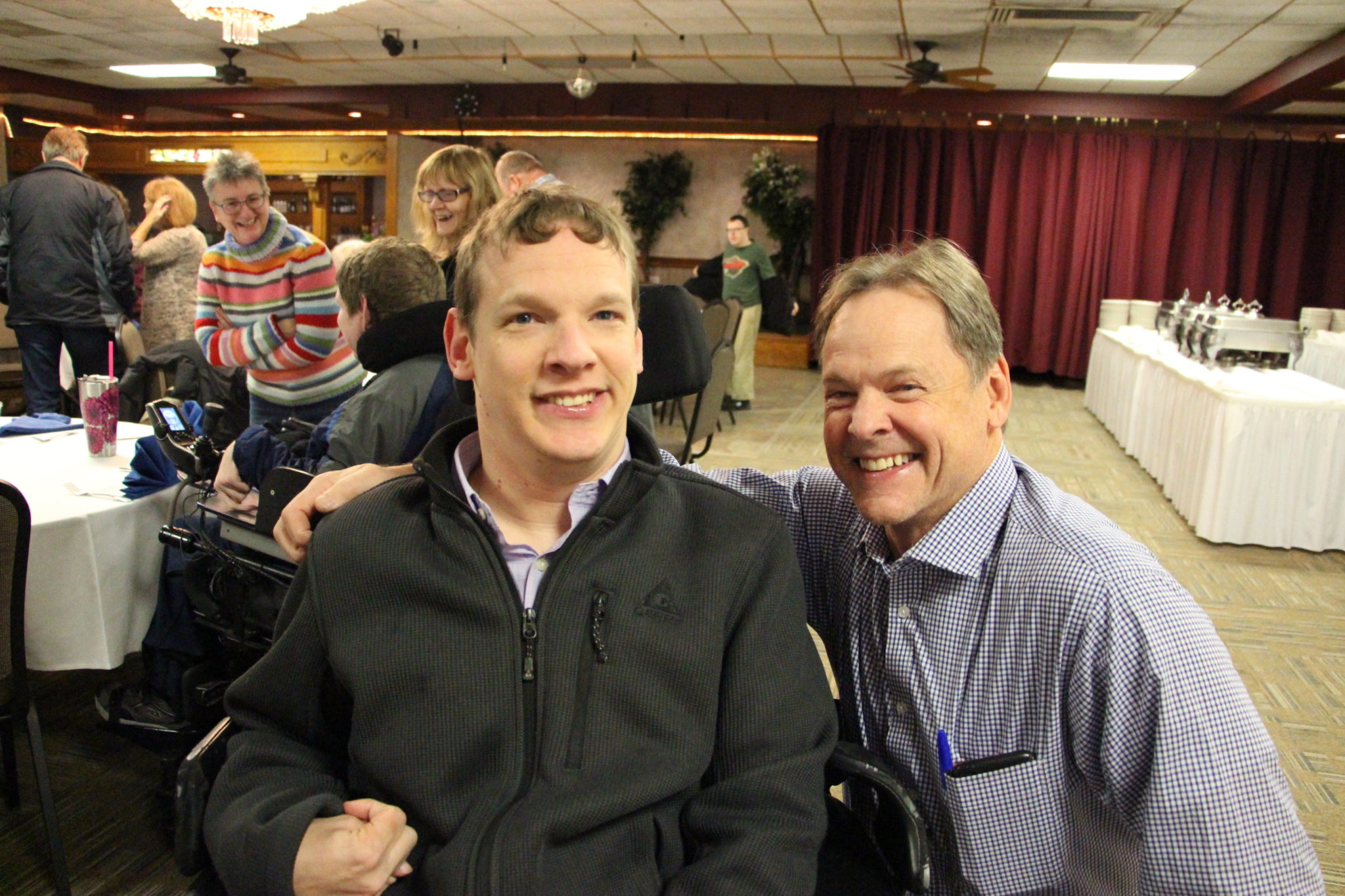 Jameson and Tom pose together at Achieve's Fall Fundraiser